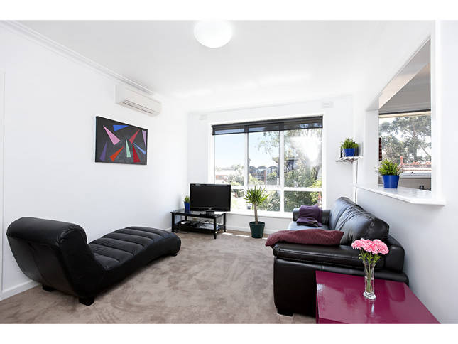 Spacious lounge room with a stylish new leather couch